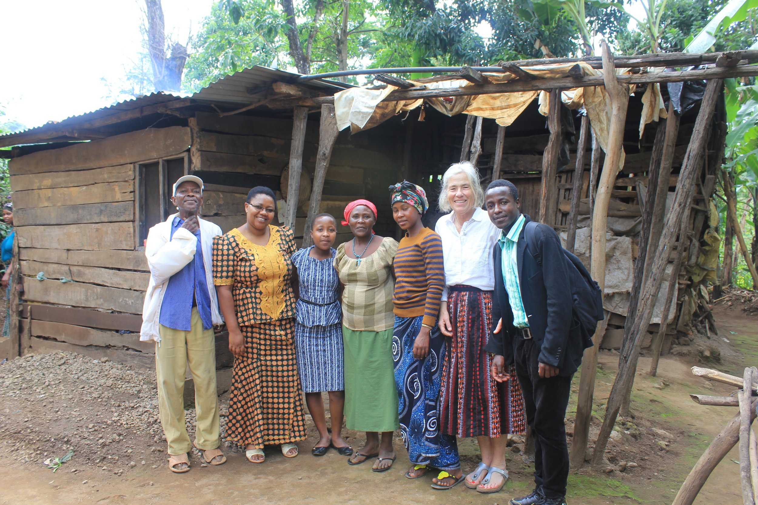 Melanie with her family and TGFT director, Estahappy and founder. (Courtesy of Nano Chatfield / The Girls Foundation of Tanzania)