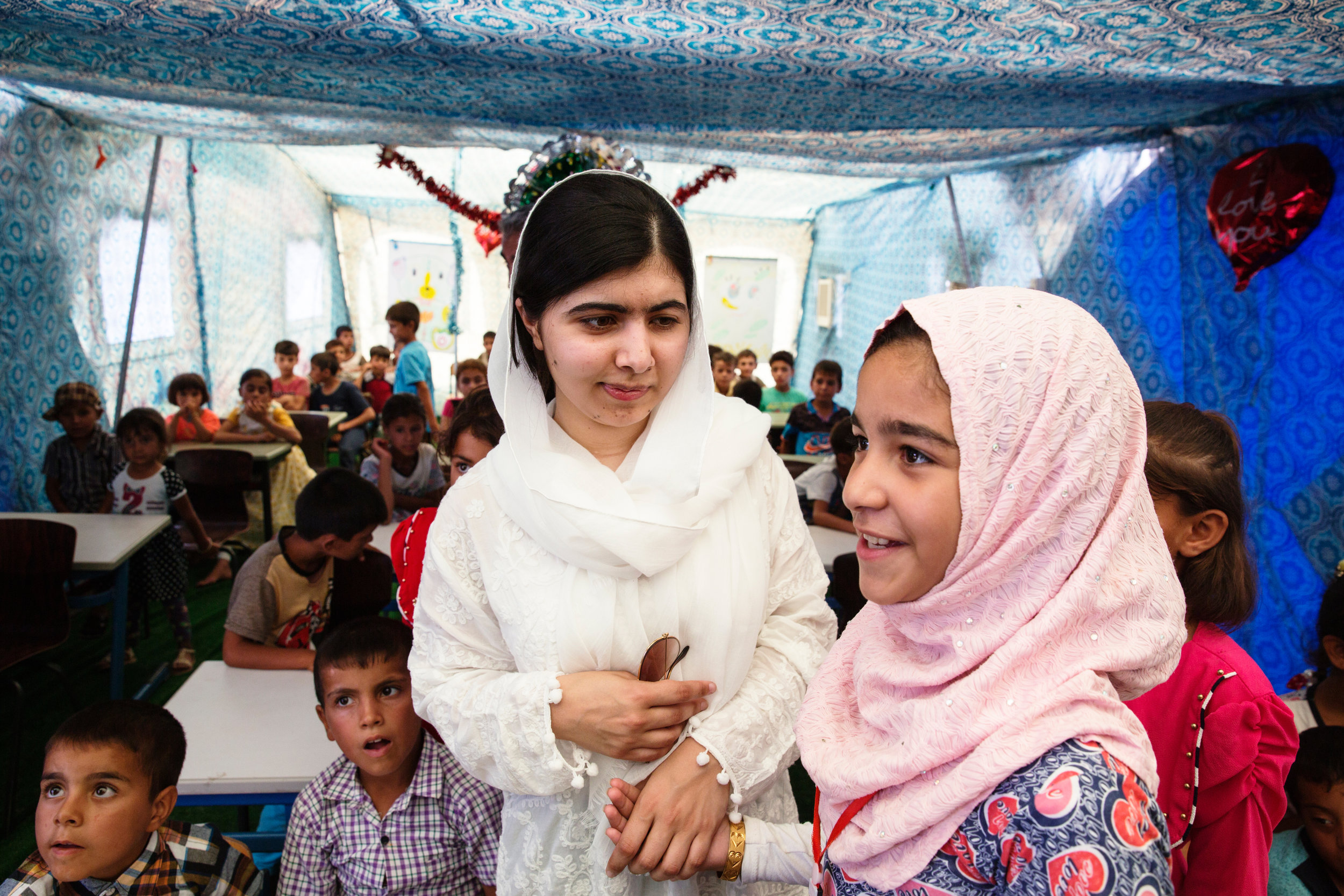 In 2017, Malin travelled with Malala to Iraq and Kurdistan. In this picture, Malala meets girls at a camp for Mosul evacuees. (Courtesy of Malin Fezehai / Malala Fund)