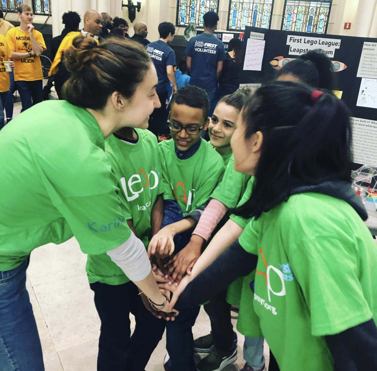 Karina coaching her robotics team. (Courtesy of Karina Popovich)