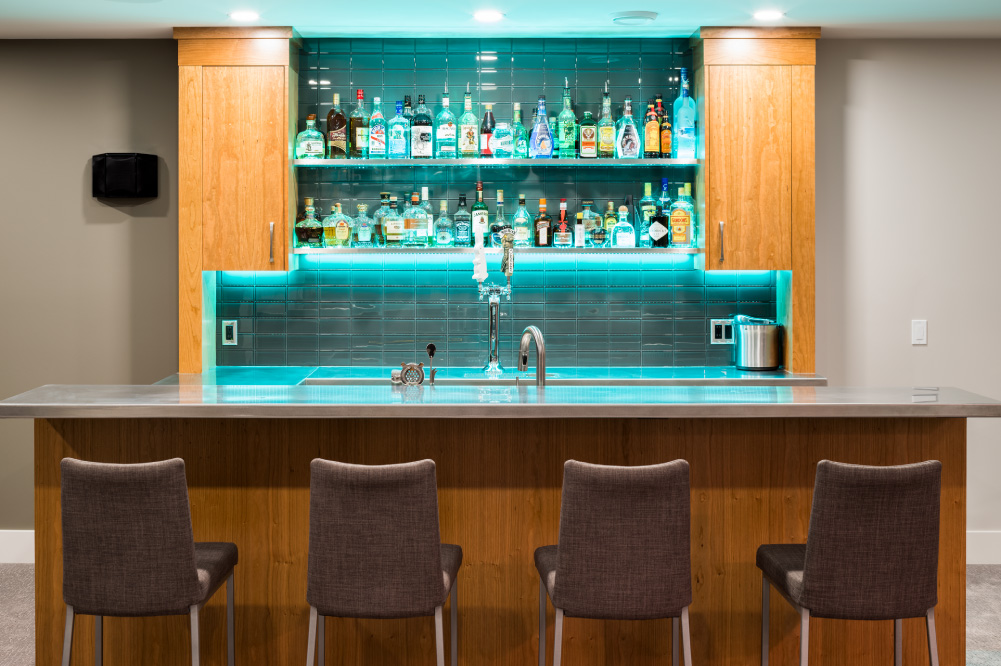 Custom basement development in Brentwood, Calgary, with full bar and dual beer tap