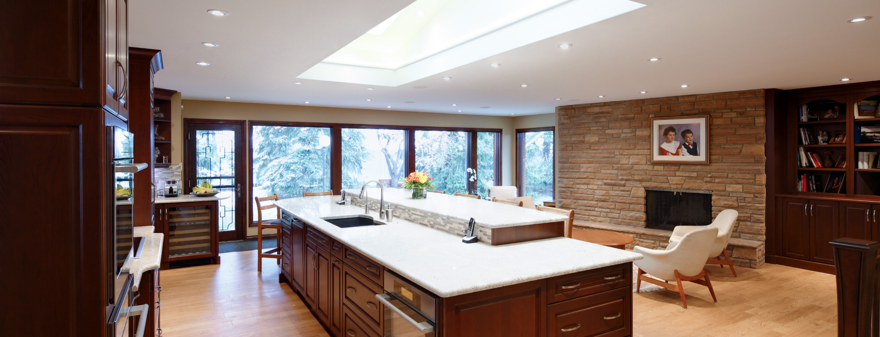 Custom Calgary open-concept kitchen renovation with skylight and heated floors.