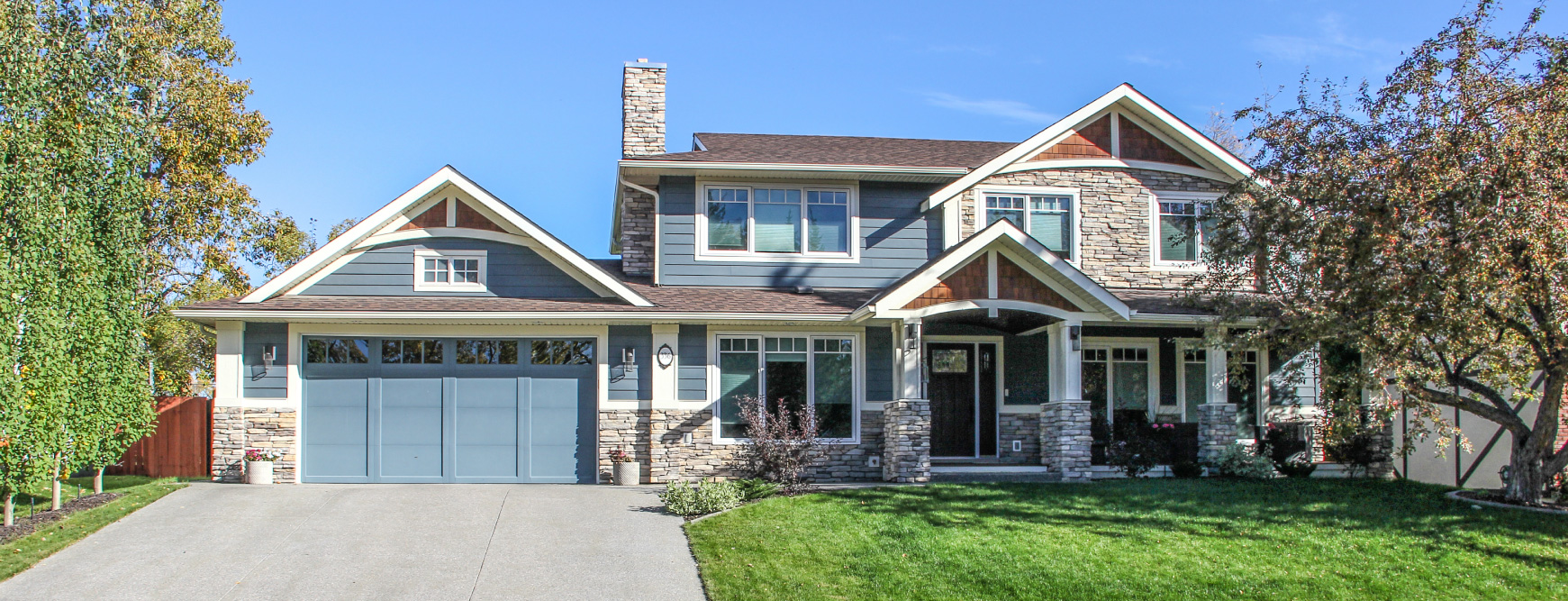 Exterior renovation with Hardi board siding and covered porch in Calgary