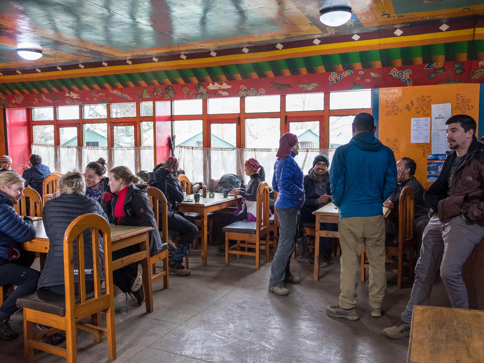 Trekkers warming up inside Cafe Tengboche, Tengboche, Nepal.