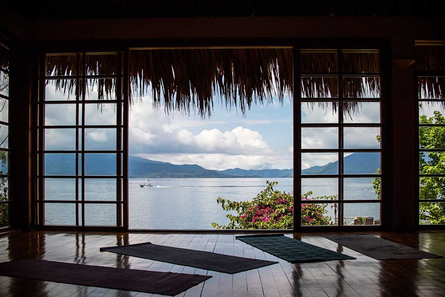 Yoga on Lake Atitlán - While San Marcos may be the lake's designated yogi village, our favorite retreat is in Santa Cruz, a low-key, car-free village only accessible by boat. Woman-owned Villa Sumaya is a lake-front, ecologically sustainable property offering personal and group retreats, 22 unique and beautifully appointed guest rooms, and a spa. The onsite restaurant focuses on organic ingredients sourced directly from their gardens or local producers. Whether you're laying down your yoga mat or relaxing in the hammock on your room's private patio, the views throughout this special property are magnificent.