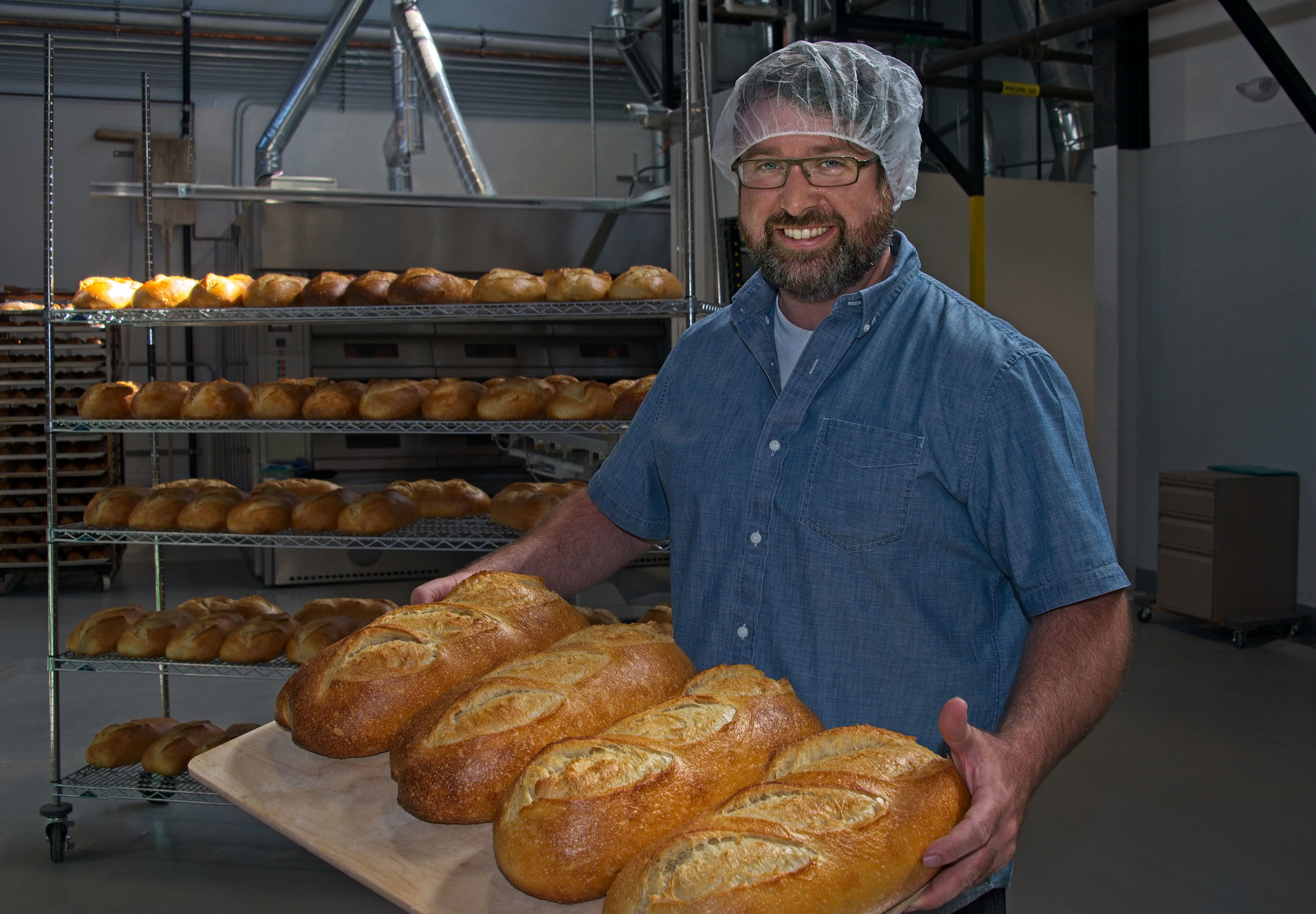 Starter Bakery owner Brian Wood at his new Berkeley location. Photo courtesy  Frank Wing Photography .