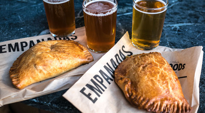 The perfect pairing: A flight from the Wood Brewery crew and empanadas courtesy of El Porteno.