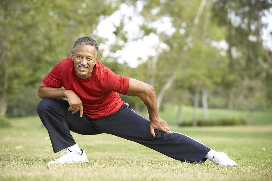 Stretching-Senior-Man-Exercising-In-Park-13909706.jpg