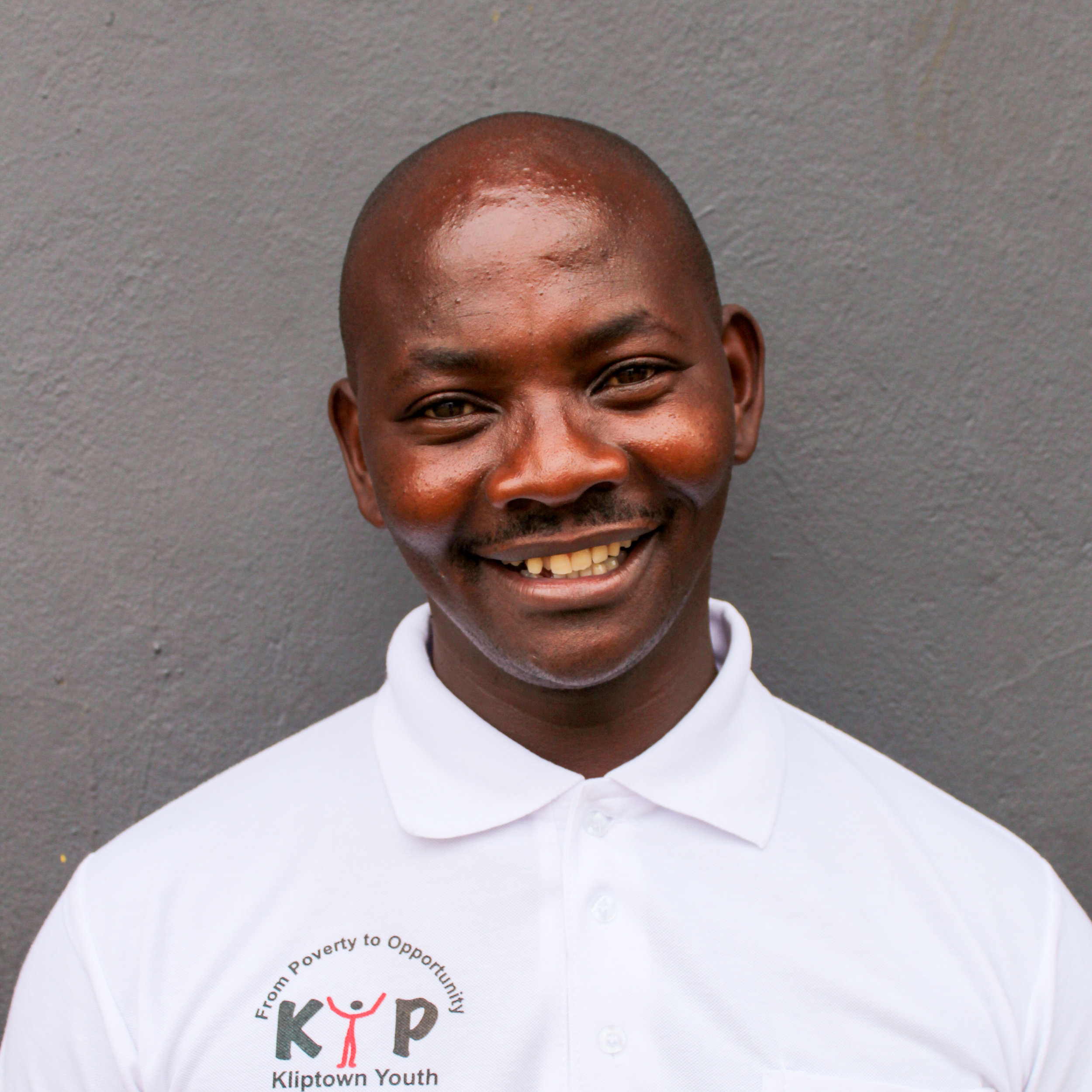 Sipho Dladla: Deputy Director    sdladla@kliptownyouthprogram.org.za   Sipho was one of the founders of KYP and ensures that all program objectives and goals are achieved. He communicates with program managers to complete each program's administrative duties. He is very competent in IT technical support and is one of the One Laptop Per Child experts. He also acts as one of the main performers and teachers of the Gumboots dance.