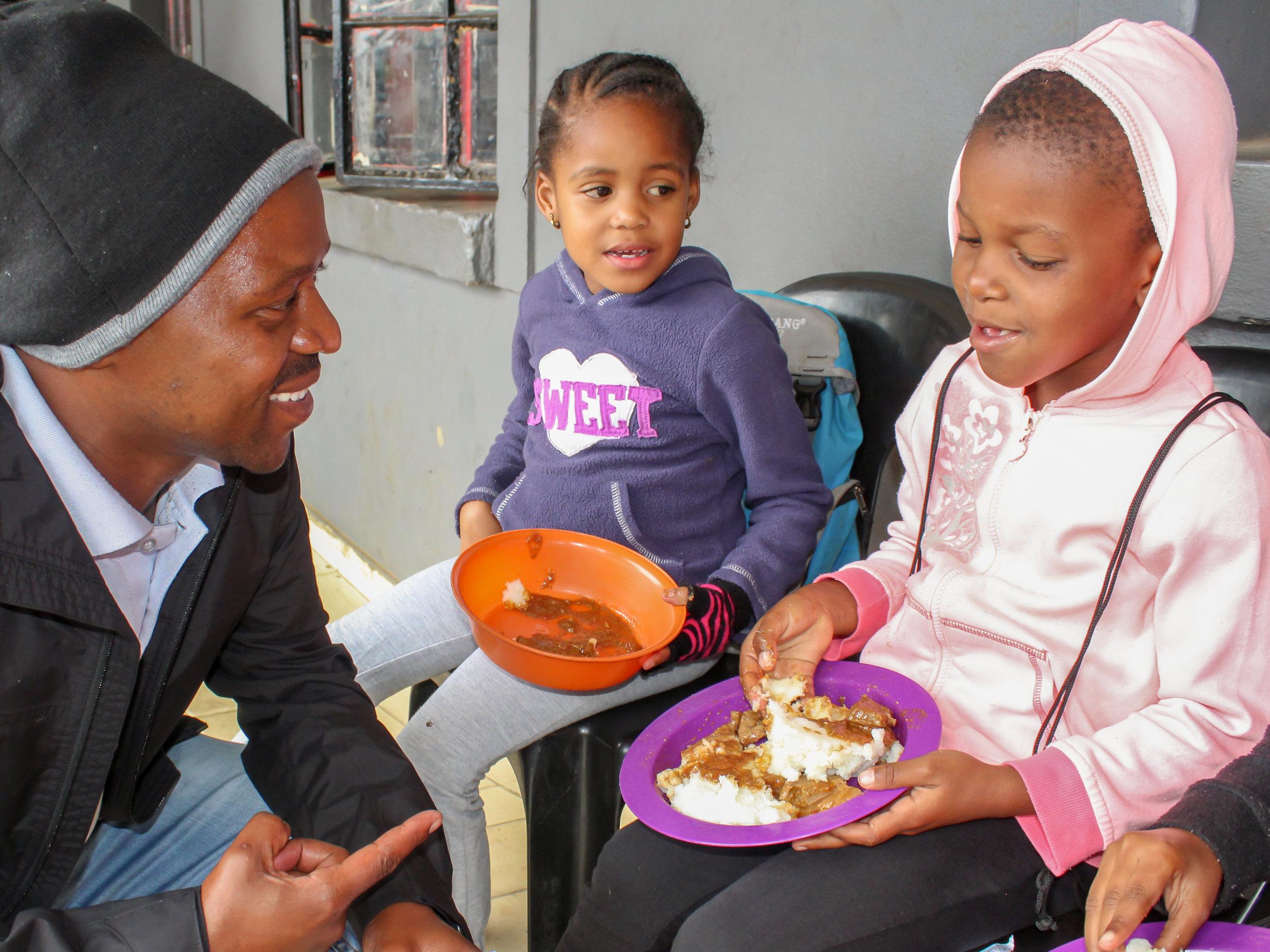 405 - Thulani with kids eating-2.jpg