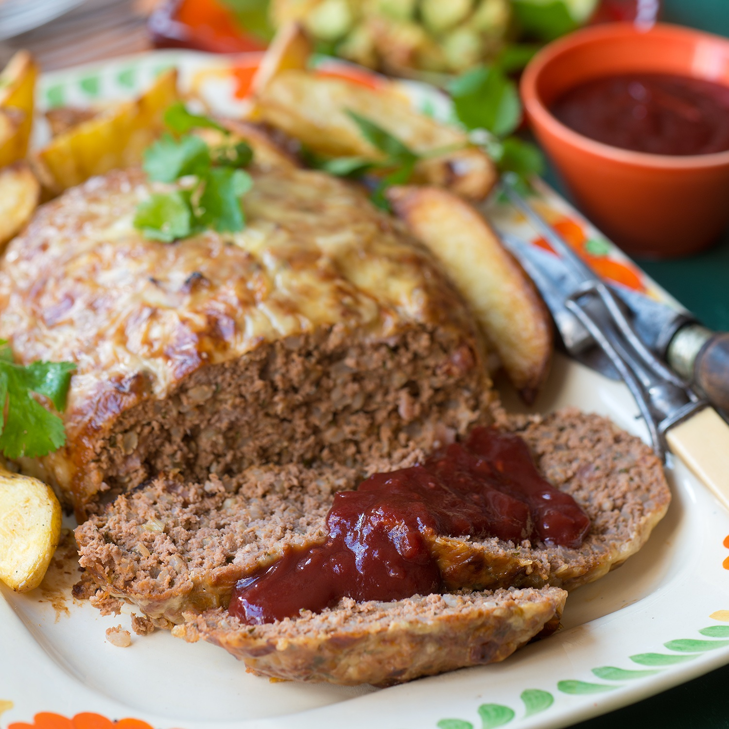 TEXAS MEATLOAF WITH GUACAMOLE - This dish embraces the full on flavours of Tabasco sauce, guacamole and sweet peppery barbecue sauce making for a sensational yet comforting southern dining experience. We like to enjoy this meatloaf with homemade potato wedges.