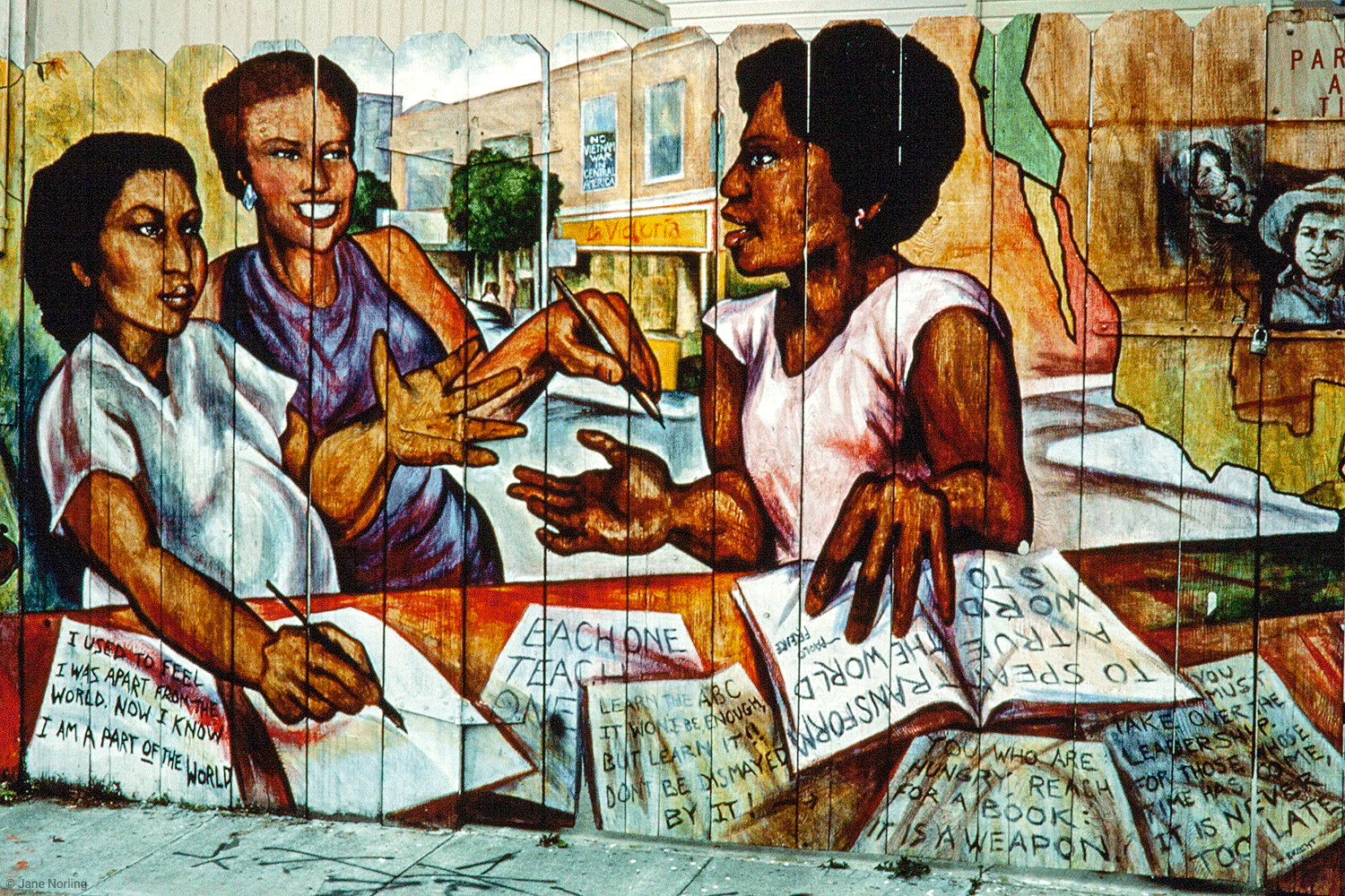 Y Enseñarles a Leer/And Teach Them to Read , PLACA murals project, Balmy Alley, San Francisco, 1984. Street scene.