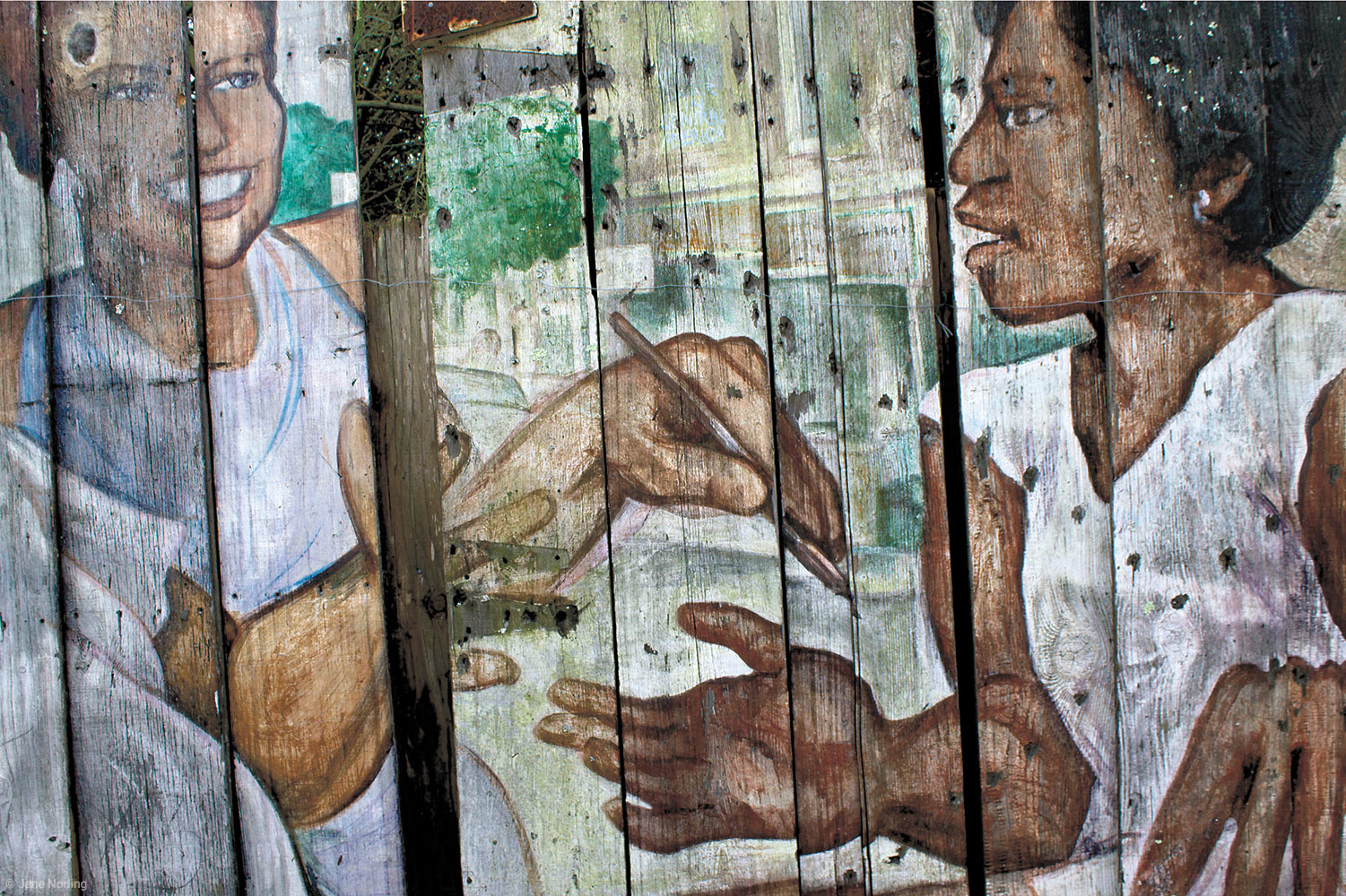 "Weathered Mural-Mission Girls , Photograph on rag paper, 17""x22"". Image from  Enseñarles a Leer/And Teach Them to Read , painted in Balmy 1984, relocated to Berkeley, California."