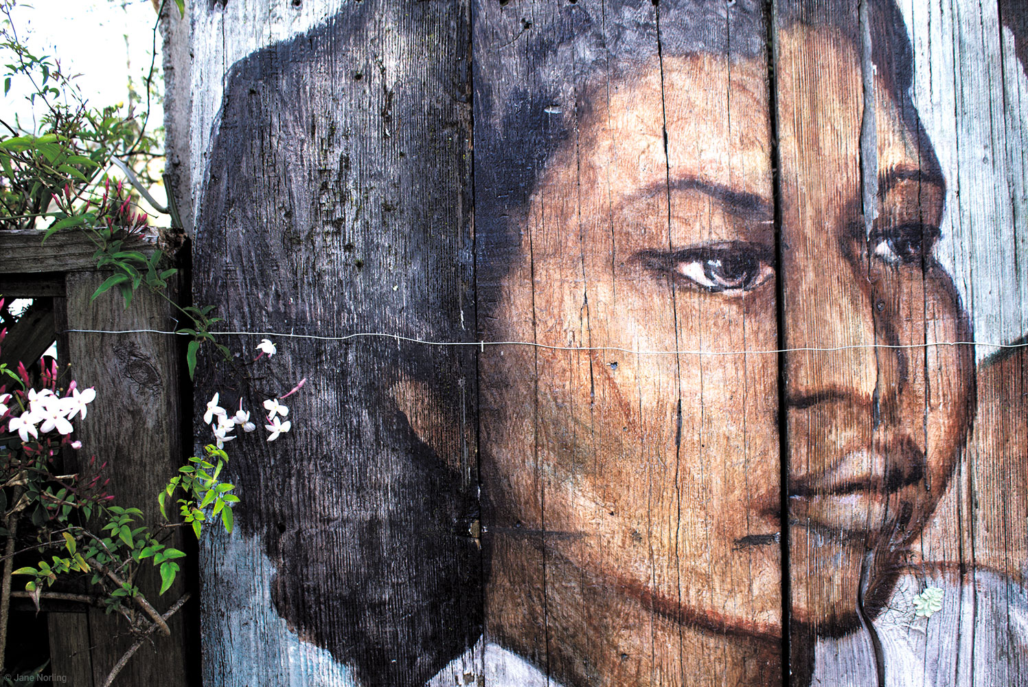 "Weathered Mural-Mission Girl , Photograph on rag paper, 17""x22"". Image from  Enseñarles a Leer/And Teach Them to Read , painted in Balmy 1984, relocated to Berkeley, California."