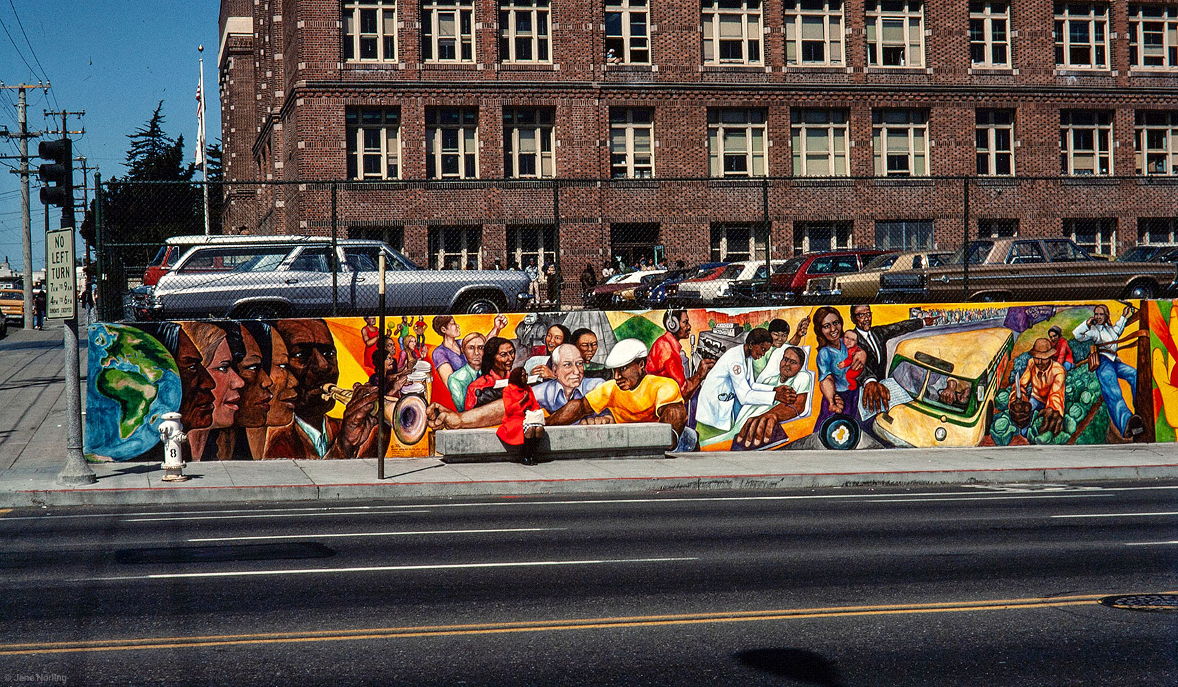 Our History is No Mystery , John Adams Community College, corner Masonic & Hayes, San Francisco CA. 400 ft. Haight Ashbury Muralists–Miranda Bergman, Jane Norling, Vicky Hamlin, Jo Tucker, Arch Williams, 1976. Illustrating San Francisco' s hidden history. Masonic Ave detail.