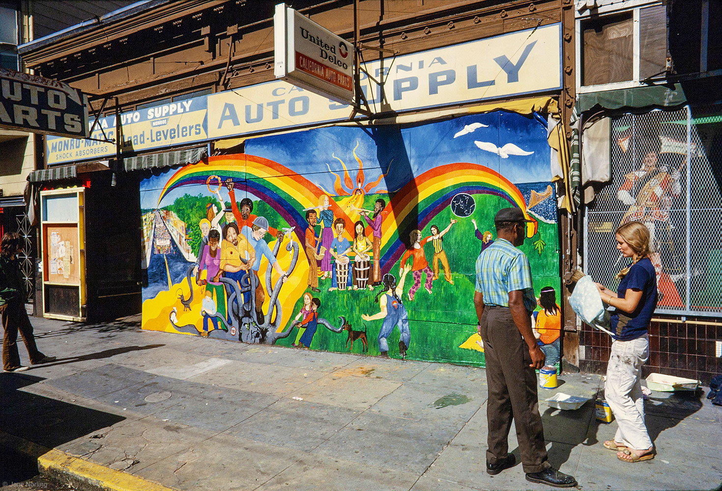 Rainbow Song , Auto Parts storefront, Haight St, San Francisco, California. Haight Ashbury Muralists, 1972. First mural of Haight Ashbury Muralists anti-imperialist group Miranda Bergman, Jane Norling, Arch Williams, with community painters. Destroyed.