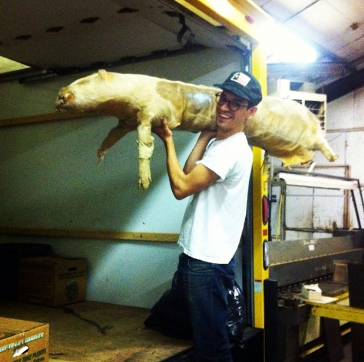 Sam loading the tattooed stuffed pig into the truck to move to LA.