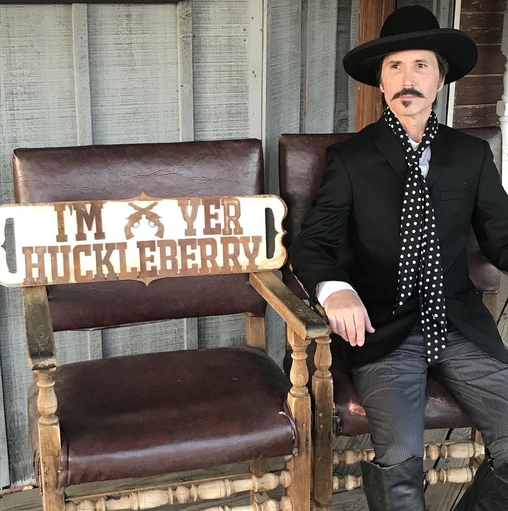 door-wide-open-rustic-sign-with-cowboy.jpeg