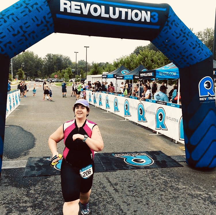 Selena crossing the finish line of the Rev3 Stafford Sprint Tri which took place on September 16th, 2018