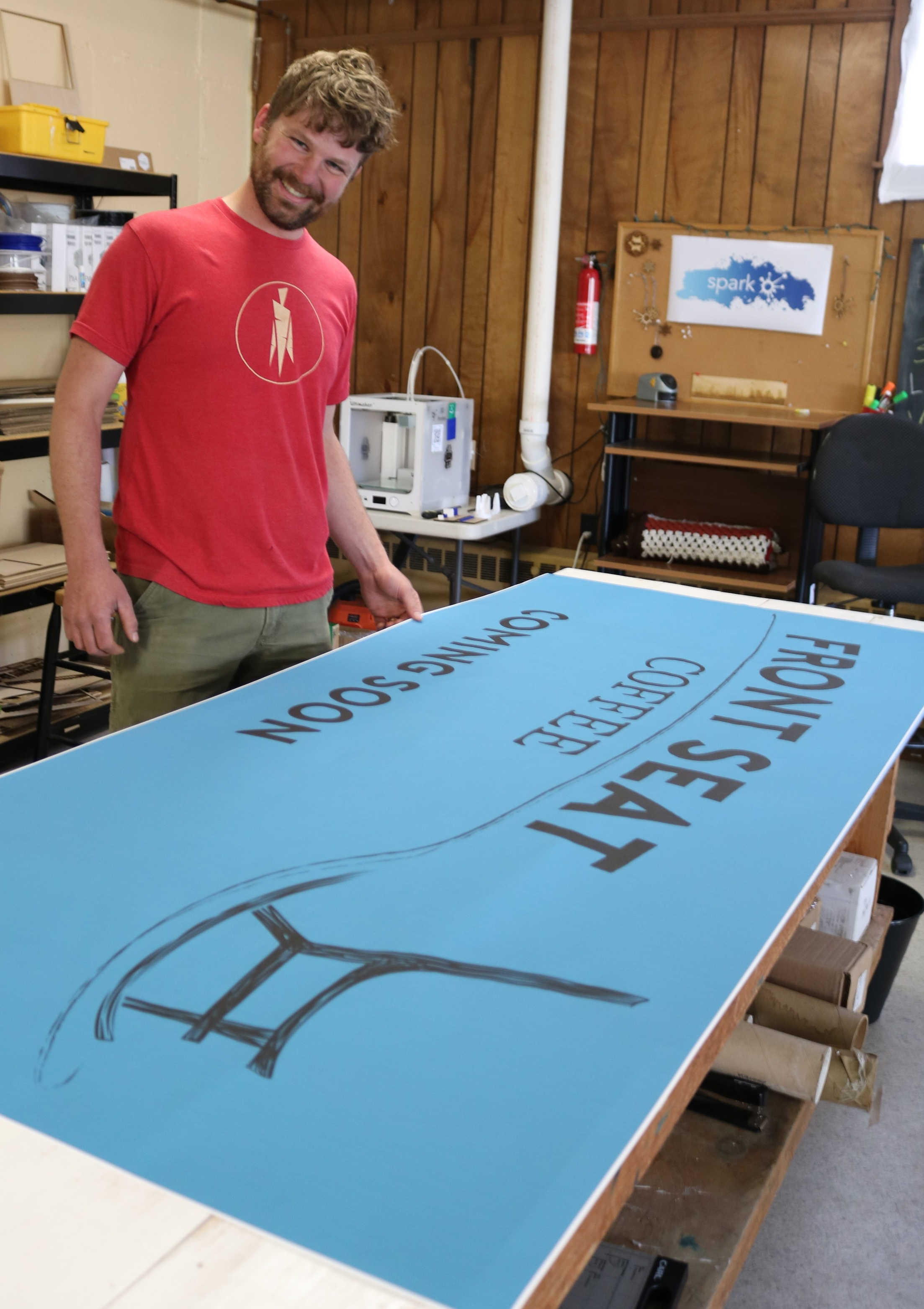 Tobin Porter and his banner promoting  Front Seat Coffee , a cafe in Hardwick set to open this summer.
