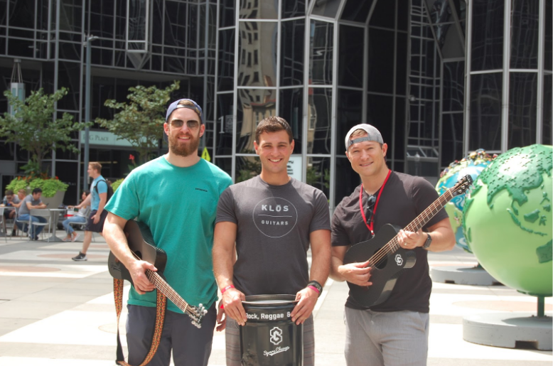 Josh, Allan, and Jared stop to take a photo in PPG Place while filming at the 2018 Rock Reggae Relief event in Pittsburgh, PA. Summer of 2018.