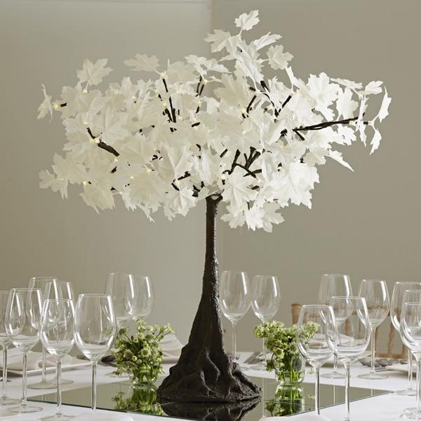 2' Table Top Tree - Our tabletop trees compliment flowers and candles or simply it stand alone for a stunning table display. Perfect for weddings, corporate events and exclusive dinner occasions.The tree uses 3 x AA batteries (included in rental price) which will begin to dim after 6-8 hours of operation.The tabletop trees are beautifully designed with bendable branches and measure 2feet tall and 2 feet wide and has 100 LEDS.(please note that there is a minimum order so mini trees are typically rented as part of a larger rental.)