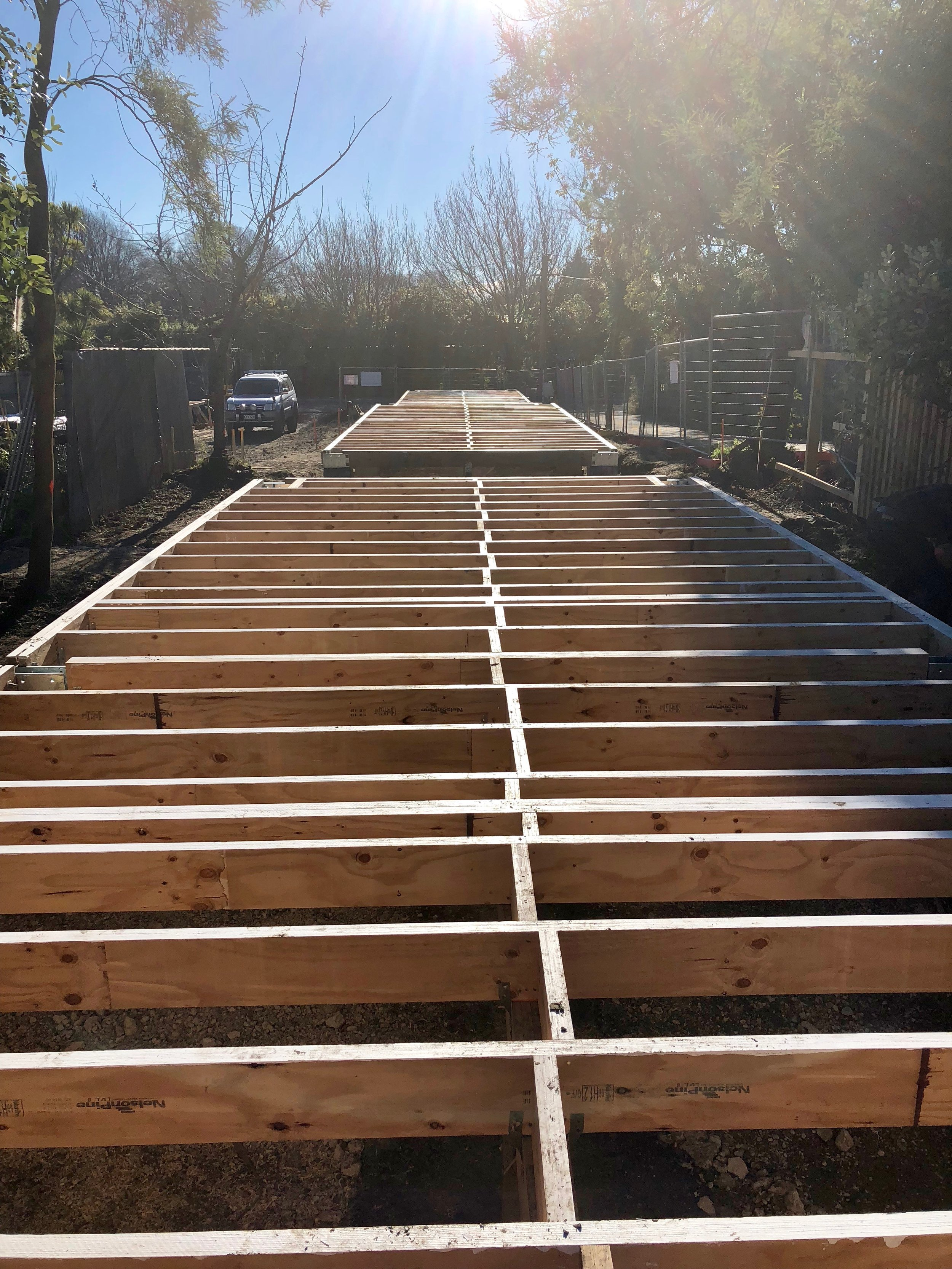Floor joists finished ready to take our flooring. As you can see our site is very narrow with no room for Cars! The adjacent driveway is not our land.