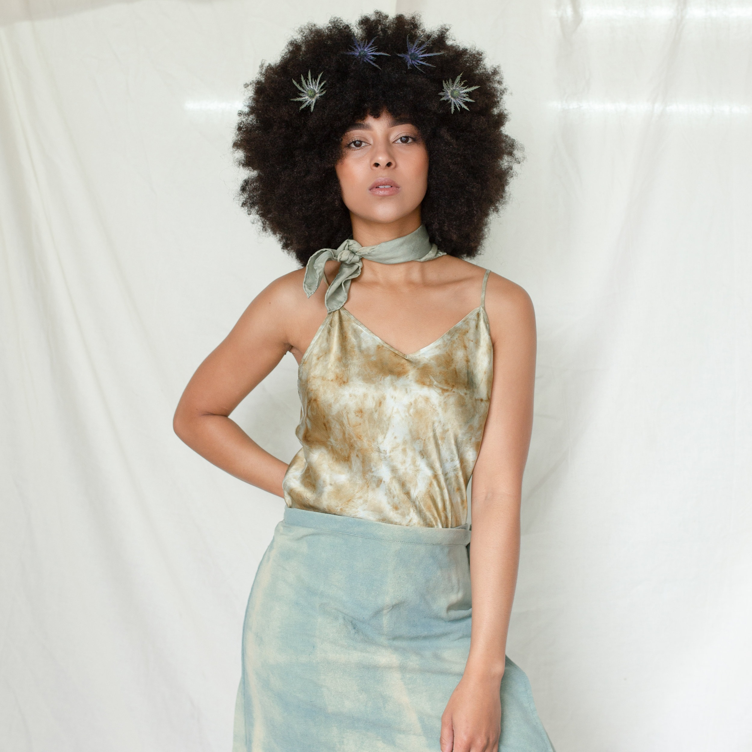 """Hannah is wearing a 16x16"""" square scarf along with a Silk Camisole Top in Ocean Eyes and a special wrap skirt we made as a prototype (dyed with pomegranate)"""