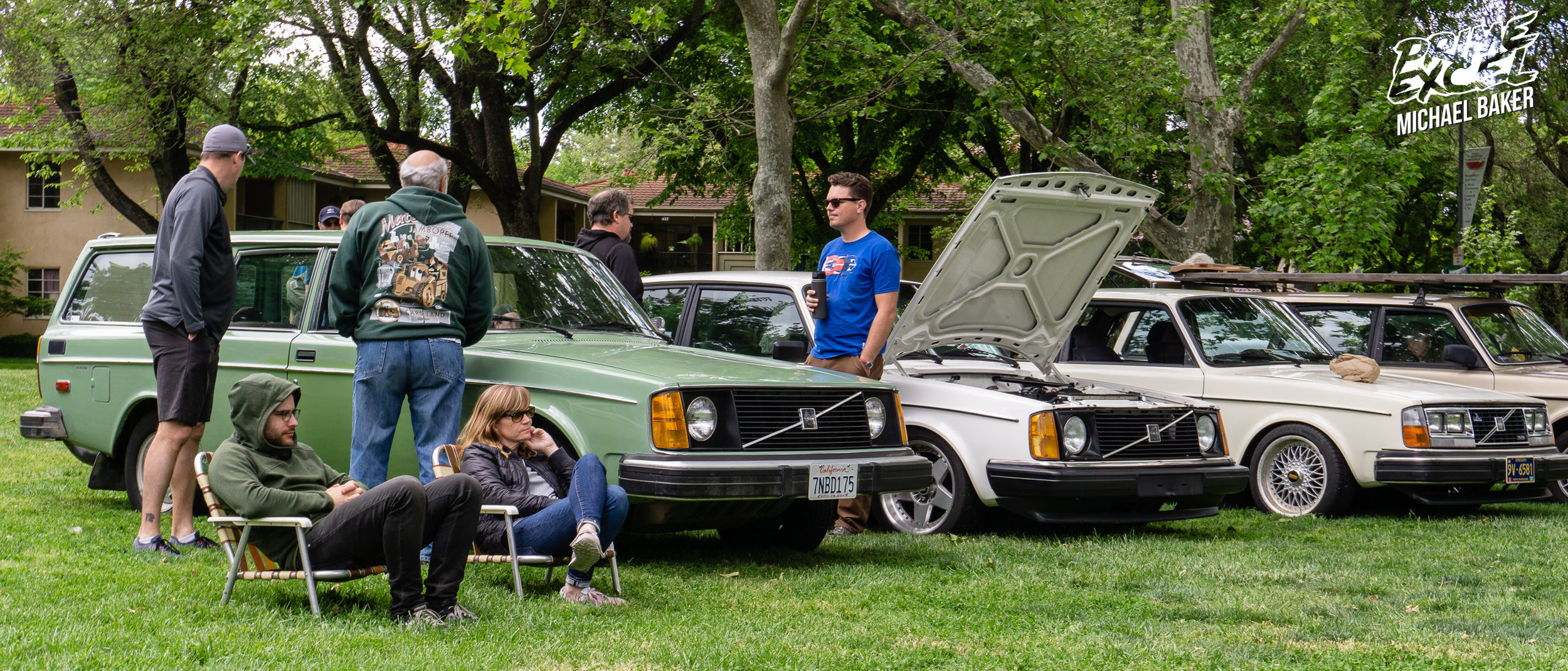 A stock and very clean 240 wagon parks next to one of the most highly modified cars at the show, a 240 coupe with a 6-cylinder Volvo engine from a 960 and truly custom two-piece wheels.