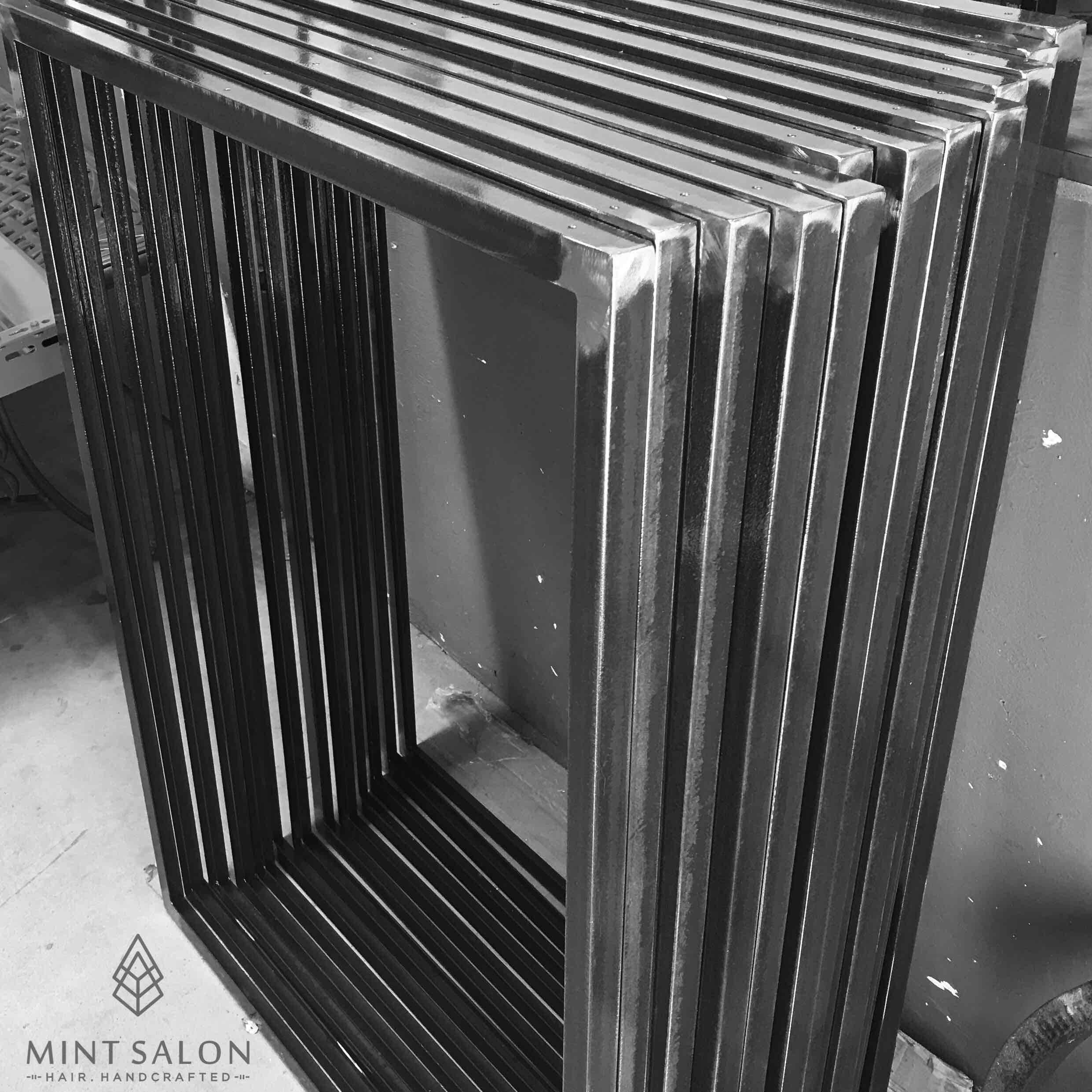 Steel mirror frames ready for wood trim and mirrors.