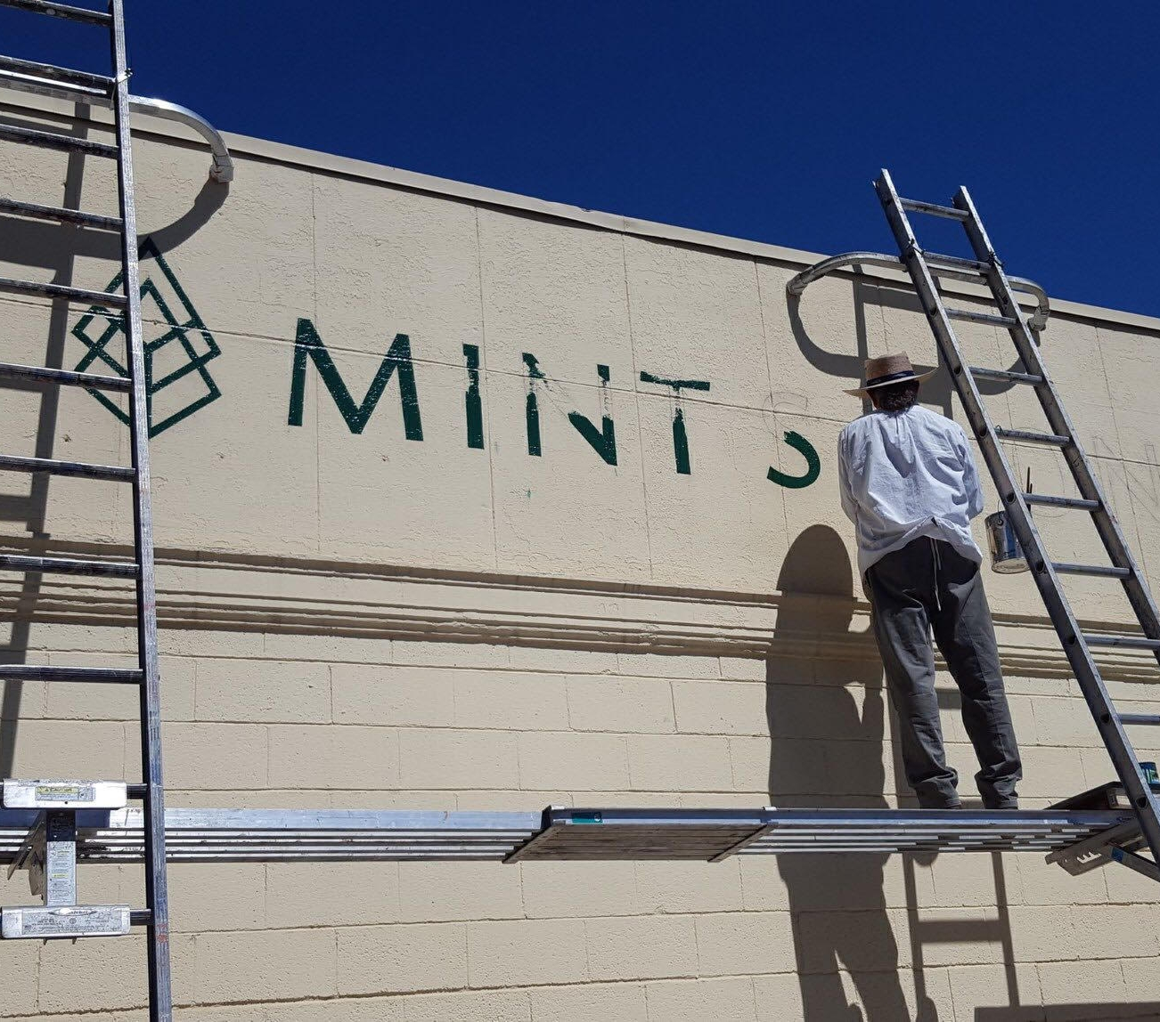 Painted sign on west side of the building by  M & M Signs and Graphics .