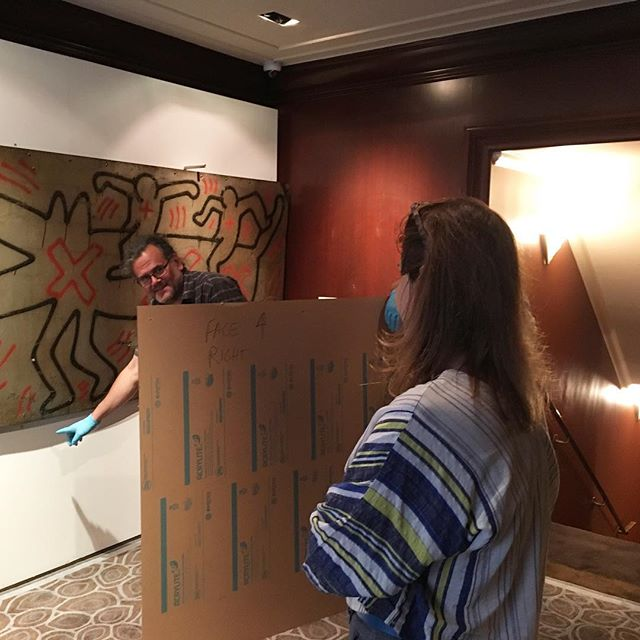 Marcia + David preparing to install a plexiglass face over this Keith Haring mural #fineart #framing #keithharing #thepeninsulahotel