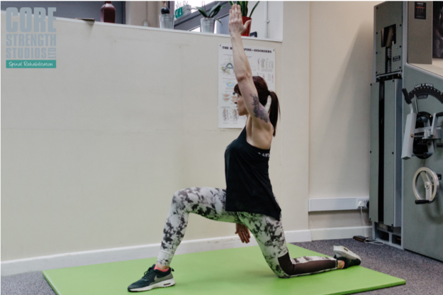 Psoas Stretch   Put one leg in front of the other and lean into the stretch, feeling it along the front of your hip. Lift your arm, rotate slightly and increase the stretch by gently leaning away