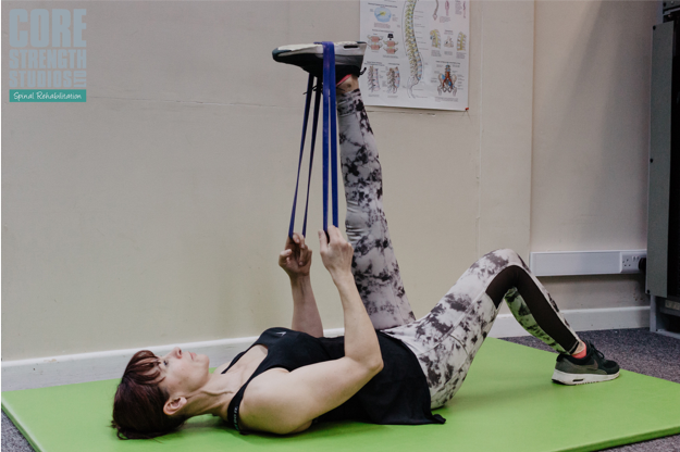 Hamstring Stretch   Use a band or rolled-up towel in the arch of your foot (not the ball of your foot) and keeping your leg straight, gently pull in towards you until you feel the stretch in the back of your thigh.