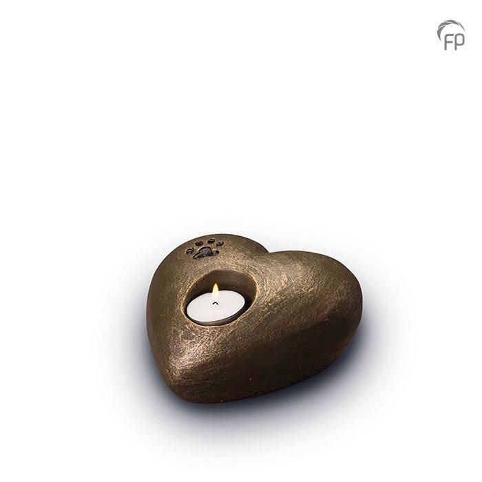UGK 204  Keramische dieren art urn met bronzen afwerking.  Elke Geert Kunen urn is uniek en wordt op bestelling gemaakt. Daarom zit er op deze producten een levertijd van 3 à 4 weken.  UGK 204 € 179,00 / 0.50 L / H 9 CM