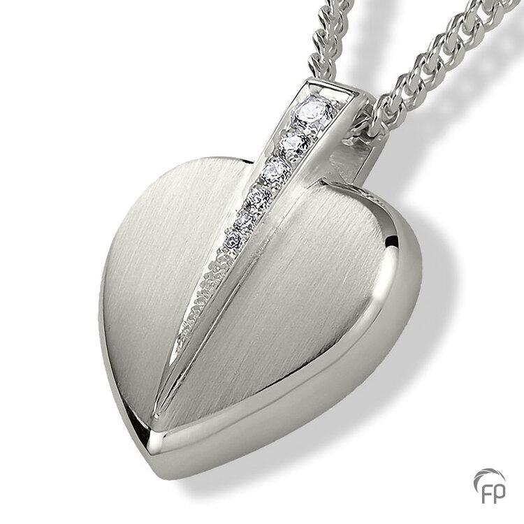 AH 085 met Zirkonia  AH 085 € 165,00 / symbolische hoeveelheid / H 2.4 CM  Bij deze sieraden in geel- en wit goud worden de Zirkonia steentjes vervangen voor echte diamanten. Prijs op aanvraag.
