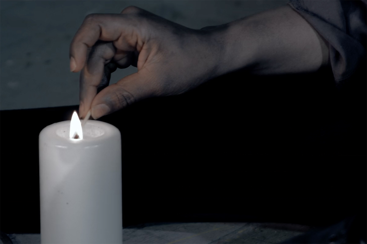 phoebe_nightingale_stay_the_burning_short_film_experimental_ronke_adekoluejo_lighting_candle.jpg
