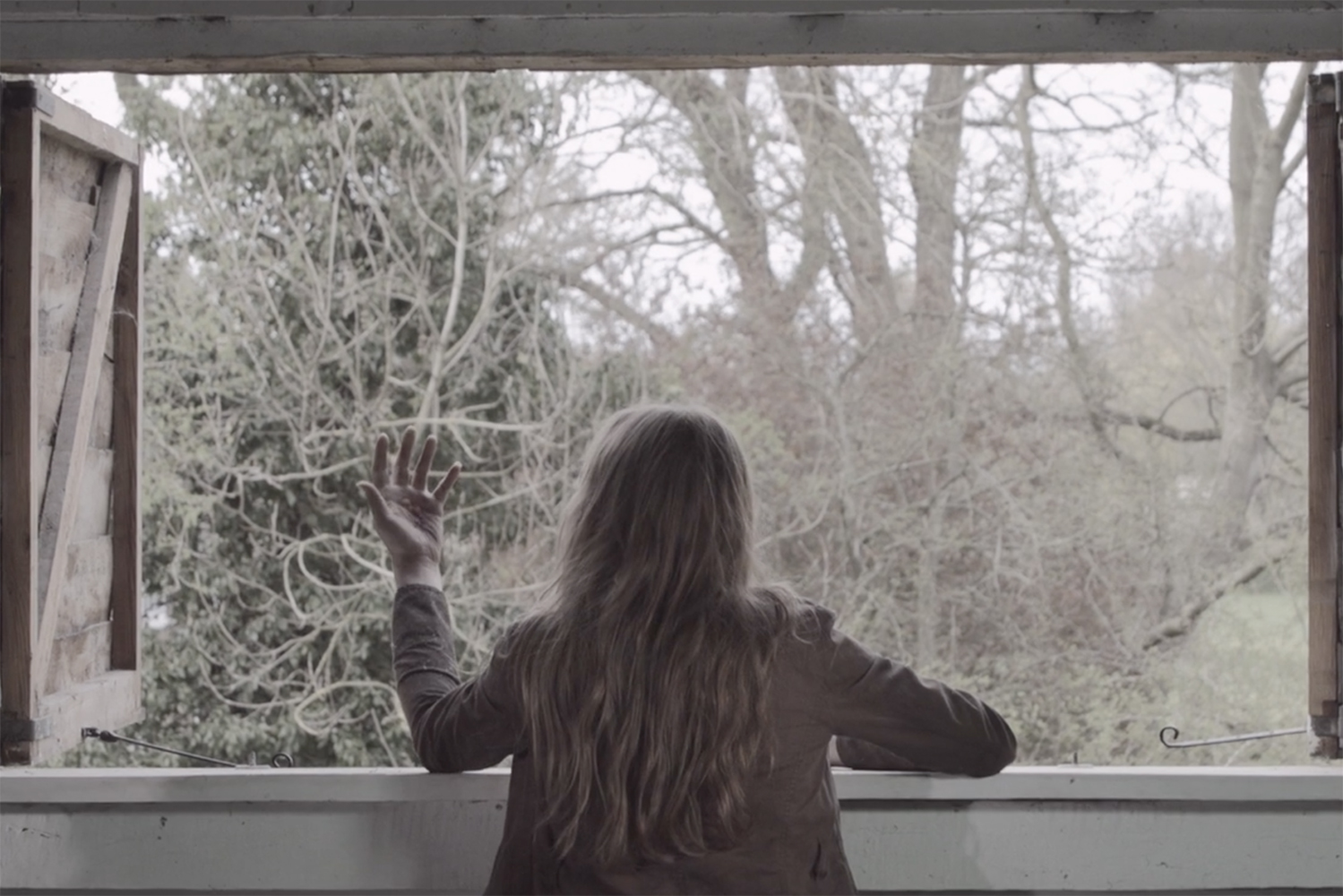 phoebe_nightingale_stay_the_burning_short_film_experimental_emma_in_window.jpg