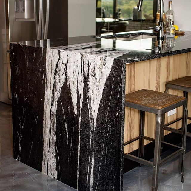 We are obsessed with this kitchen remodel! These beautiful countertops are Sky Falls Granite. Design: Natalie Troyer Design / Photos: Michael Schrader