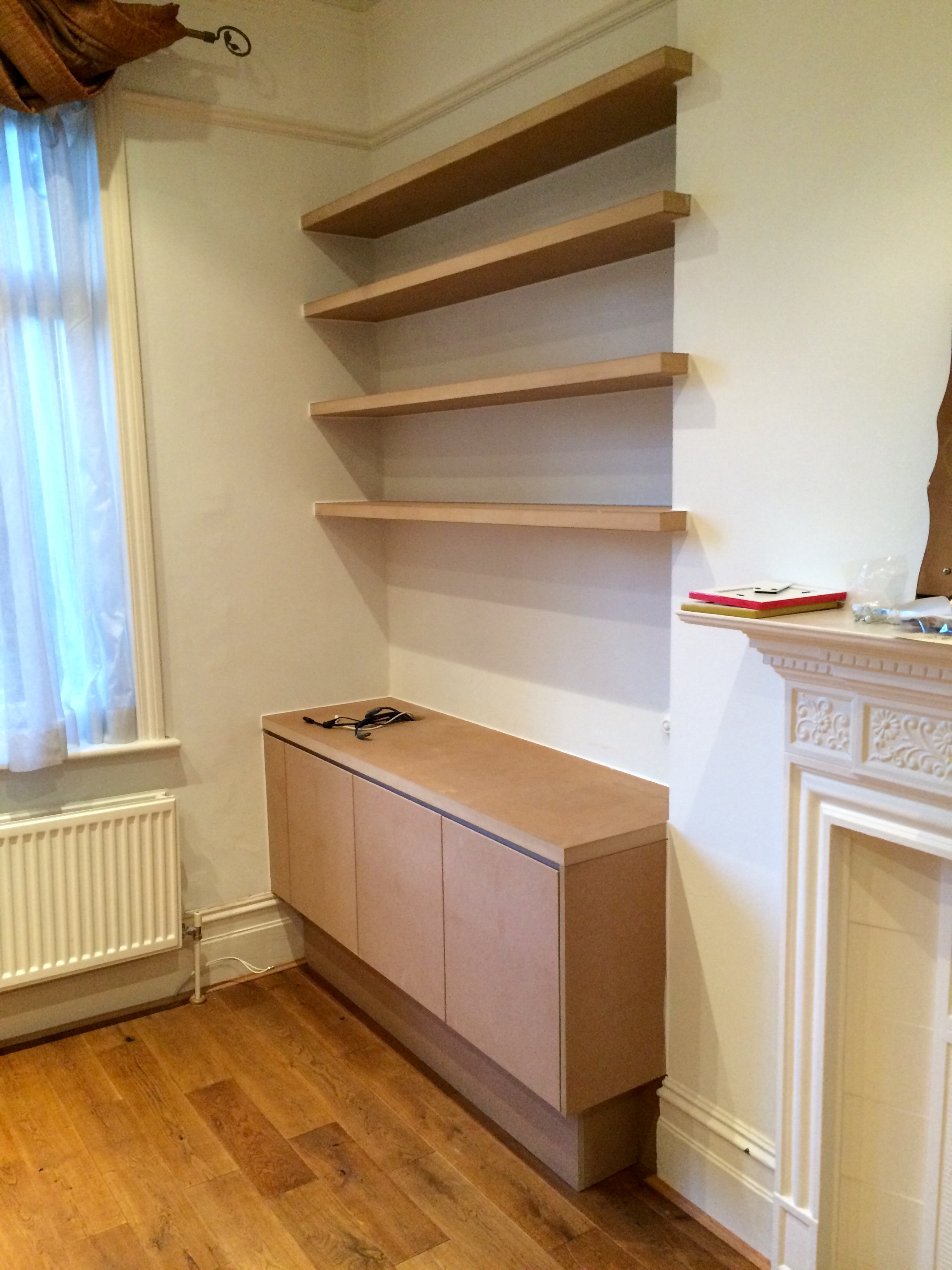 Minimalist Shelves - Minimal in style, the fitted cabinet and shelves offer a pleasing and uncluttered installation. Shown here, they await decoration.