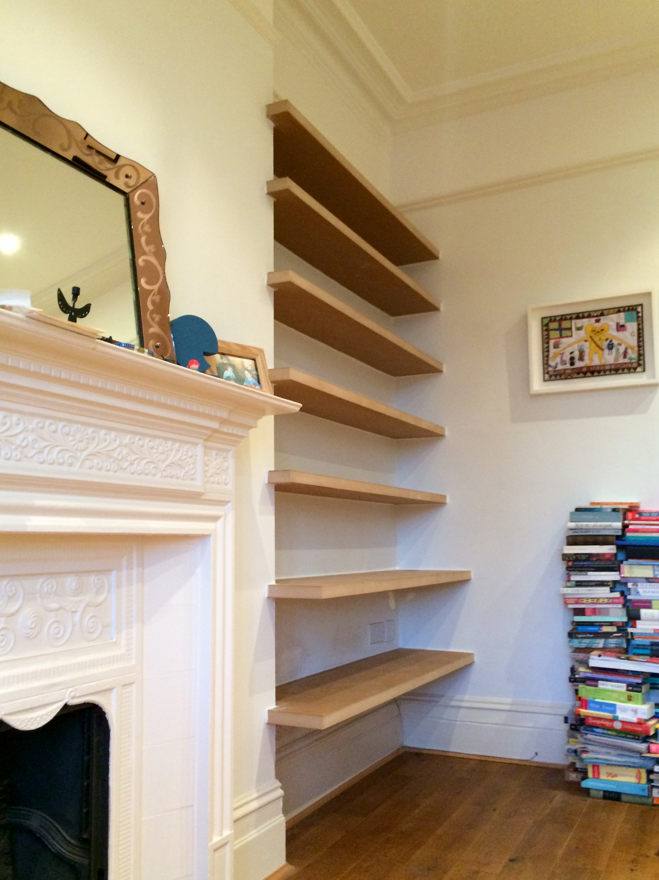 - A combination of shelf depths allow for larger books near the floor, along with a place for a stereo and lamp.