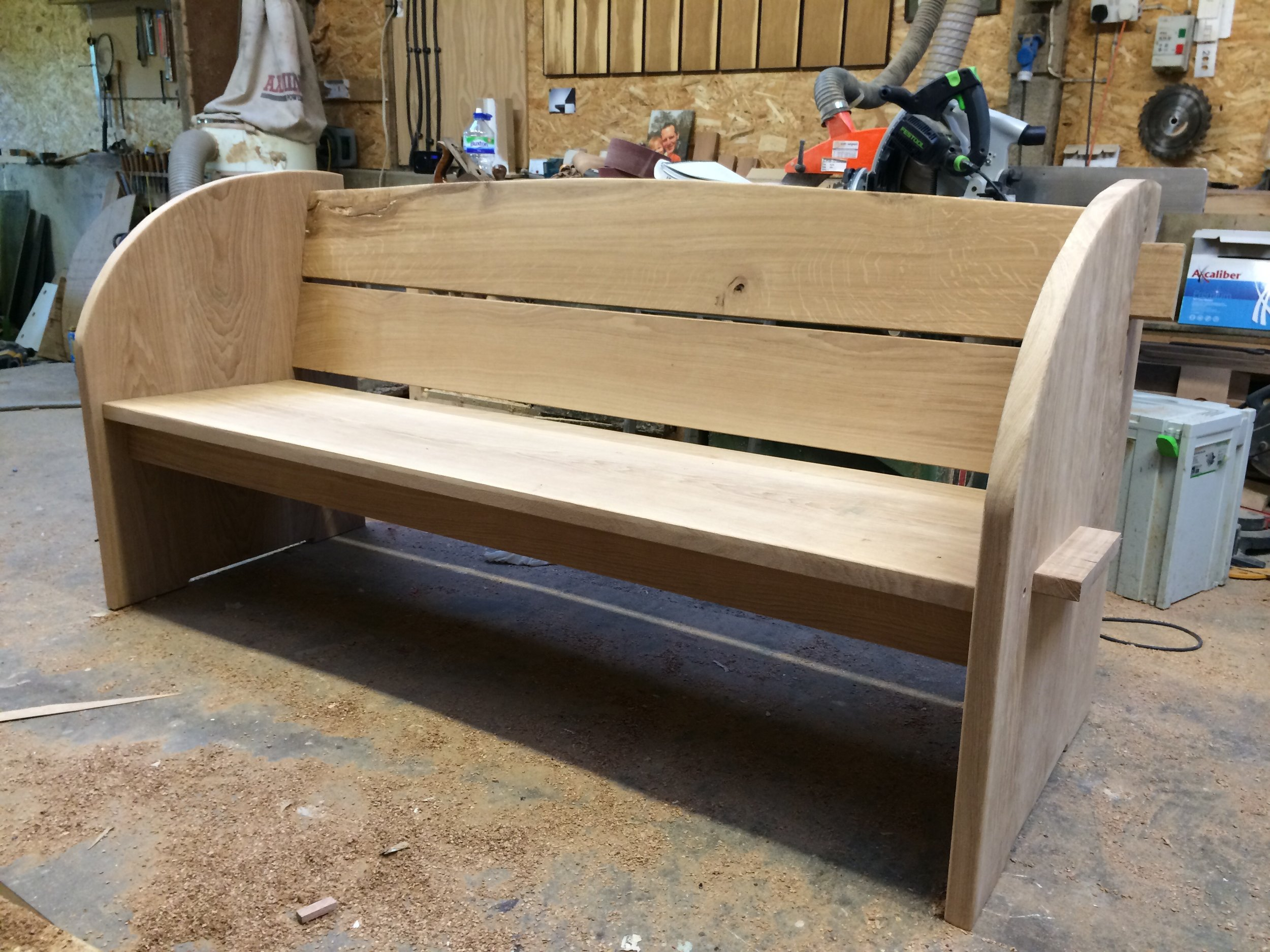 - This solid oak memorial bench will silver naturally on exposure to the elements.