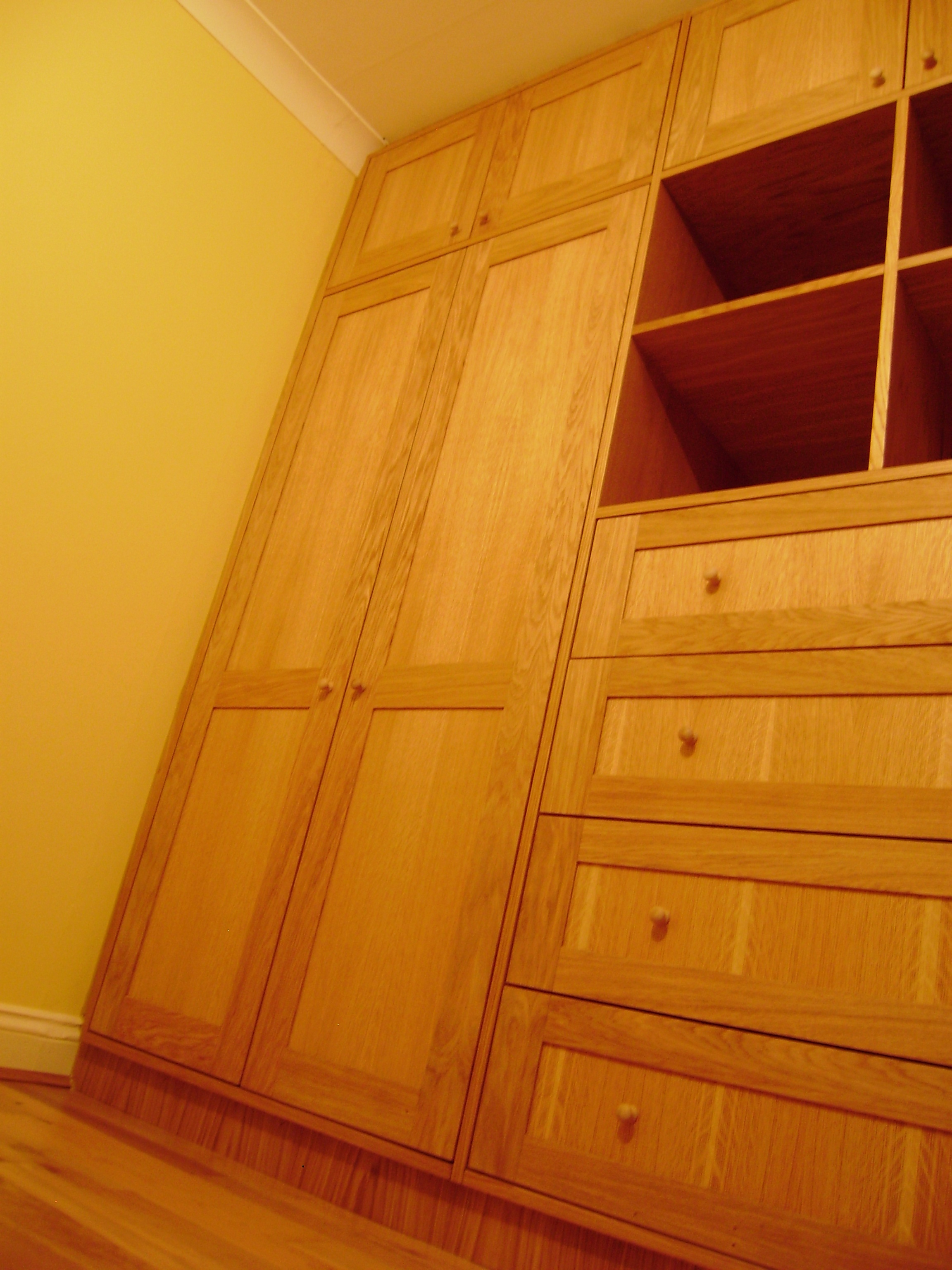 Storage - These oak wardrobes were commissioned for young twins. Particular attention has been paid to ensuring the grain of the timber flows from panel to panel.