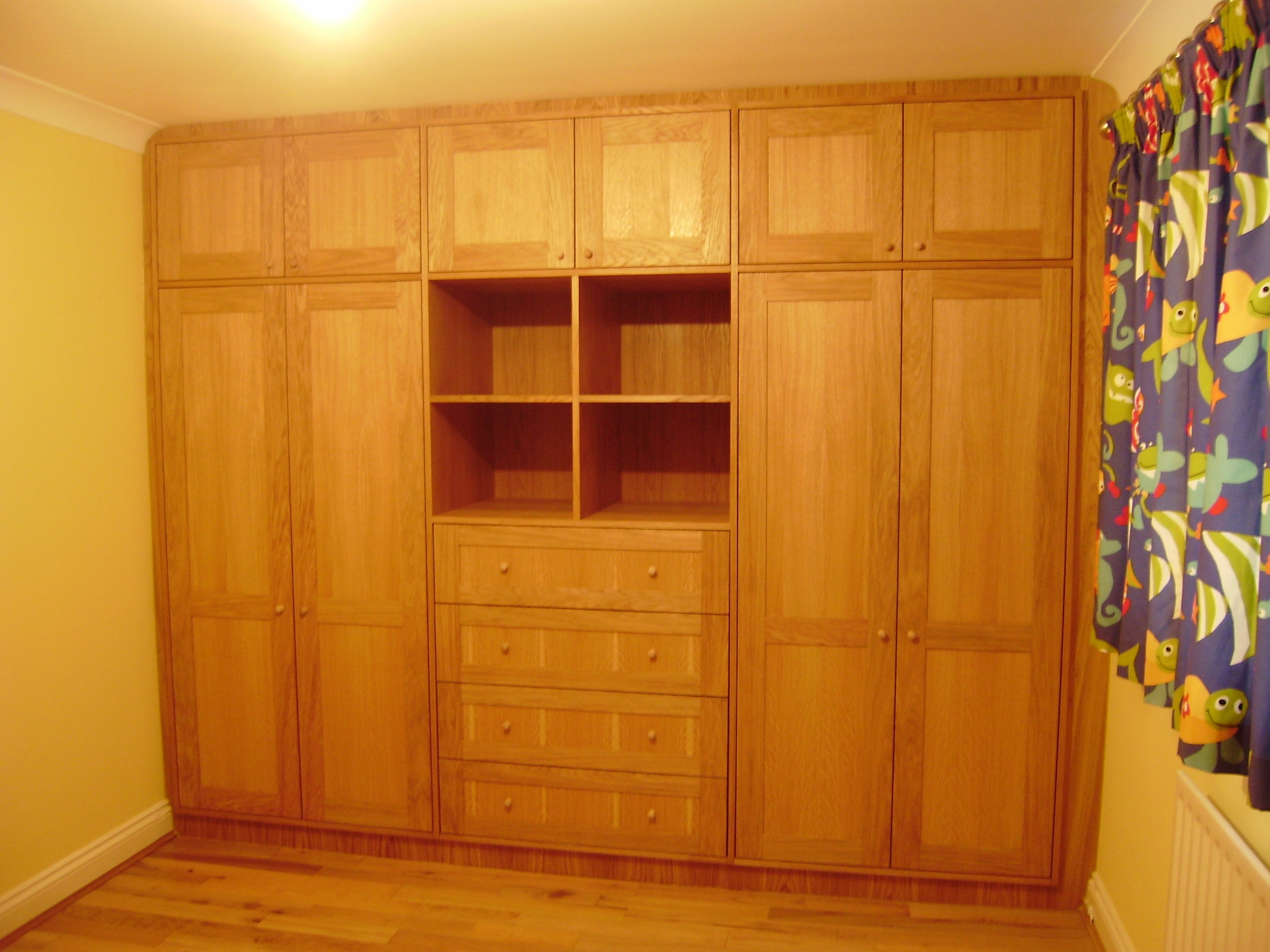 - A combination of hanging space, storage, open shelves and drawers ensure that this wardrobe is as practical as possible. Multiple hanging rail positions have been pre-arranged to accommodated larger clothing sizes as the twins grow.