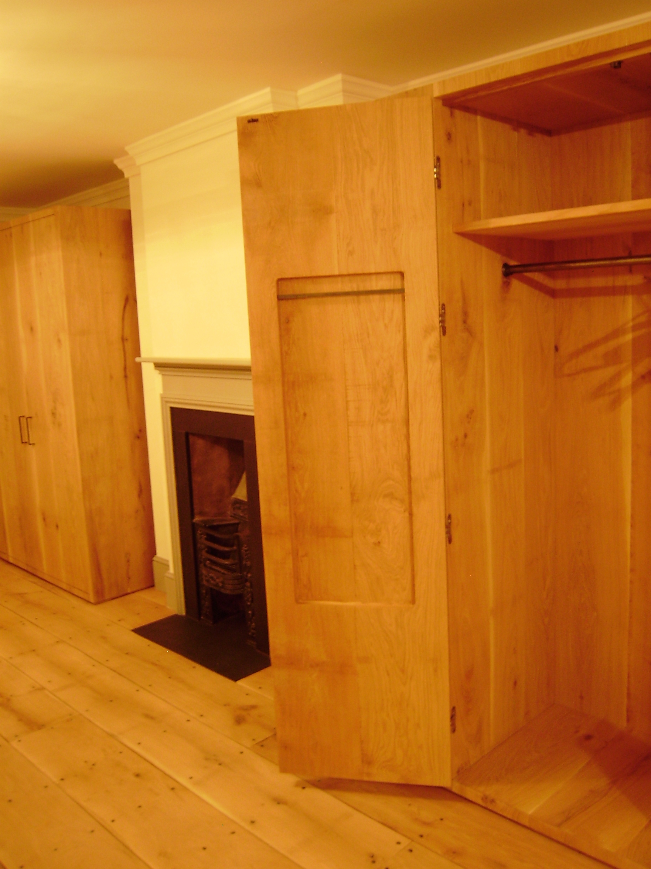 Free Standing - These free standing wardrobes are made with the same oak boards that were used for the flooring. Soss hinges and minimal ironmongery finish them perfectly.