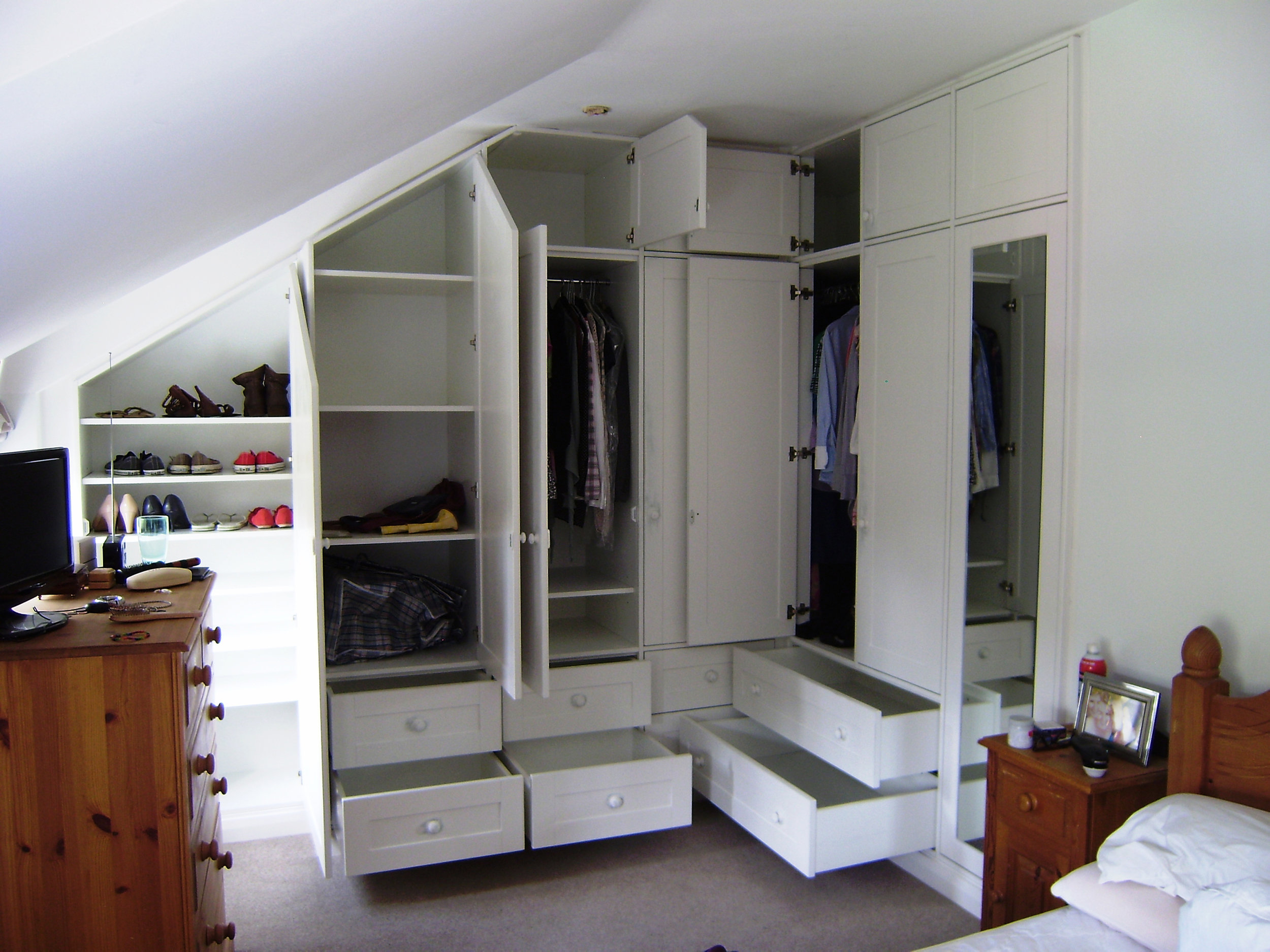 - The interior has full and half height hanging, general storage, shelving, drawers and a shoe cupboard.