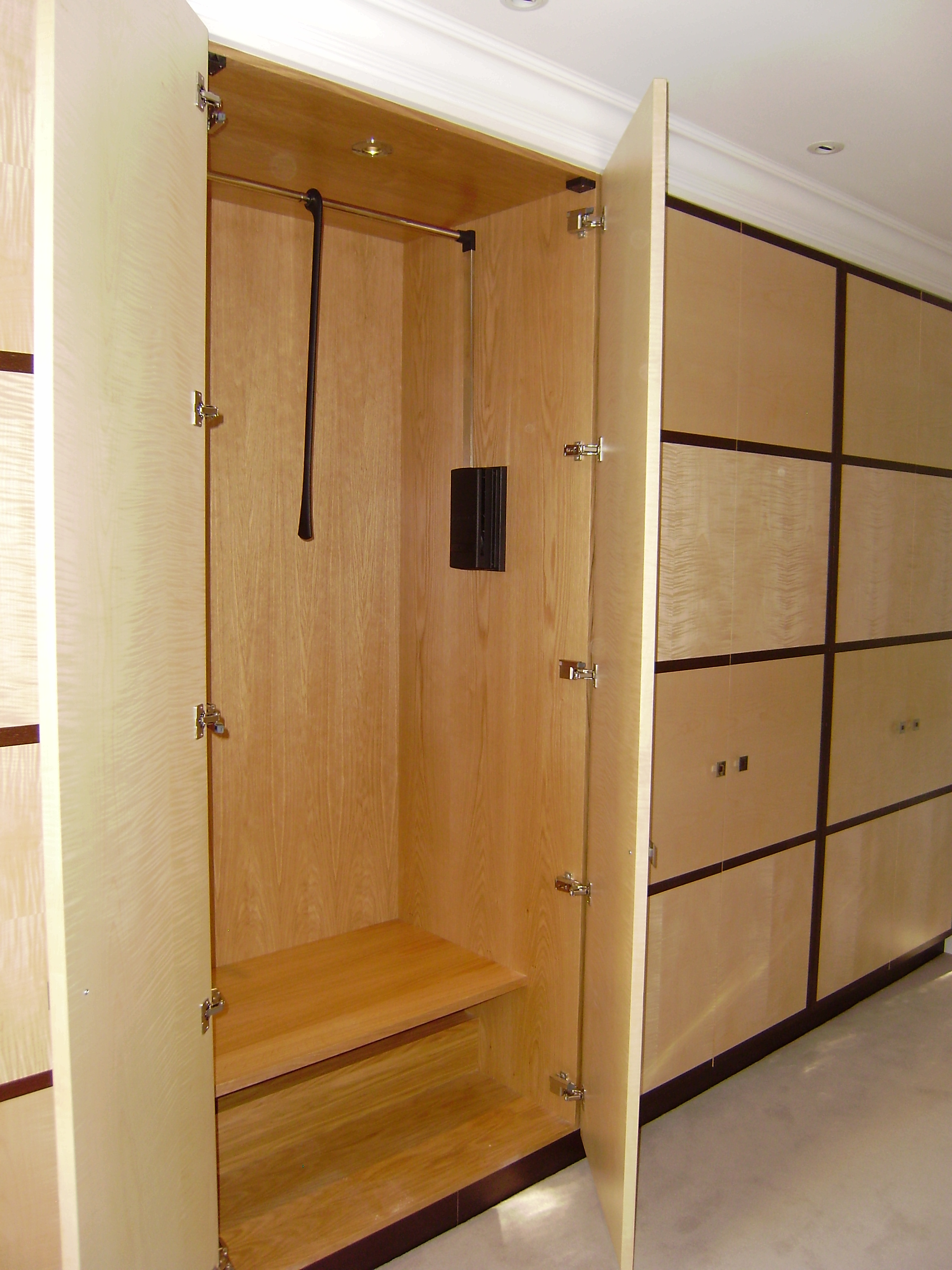 Decorative - These wardrobes have interiors of oak and doors in sycamore and wenge.