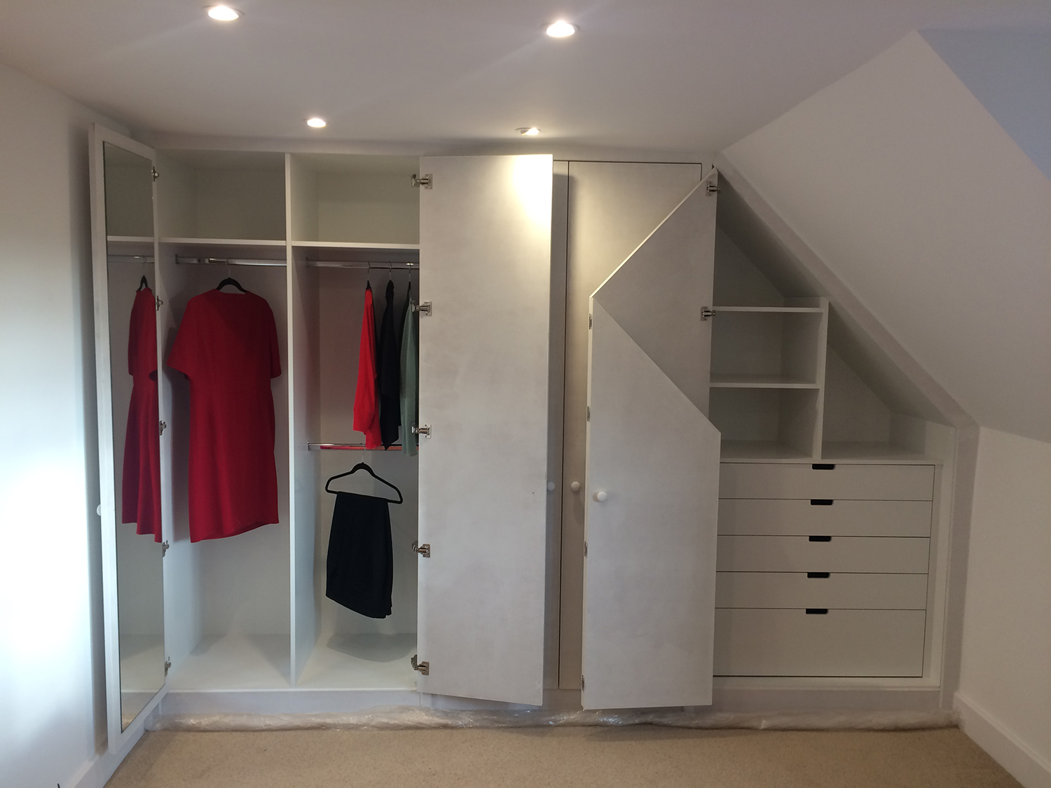 - Fitted wardrobes with a combination of storage options, all of which can be hidden behind doors for a clean look. White melamine interiors with primed doors, ready for decoration.