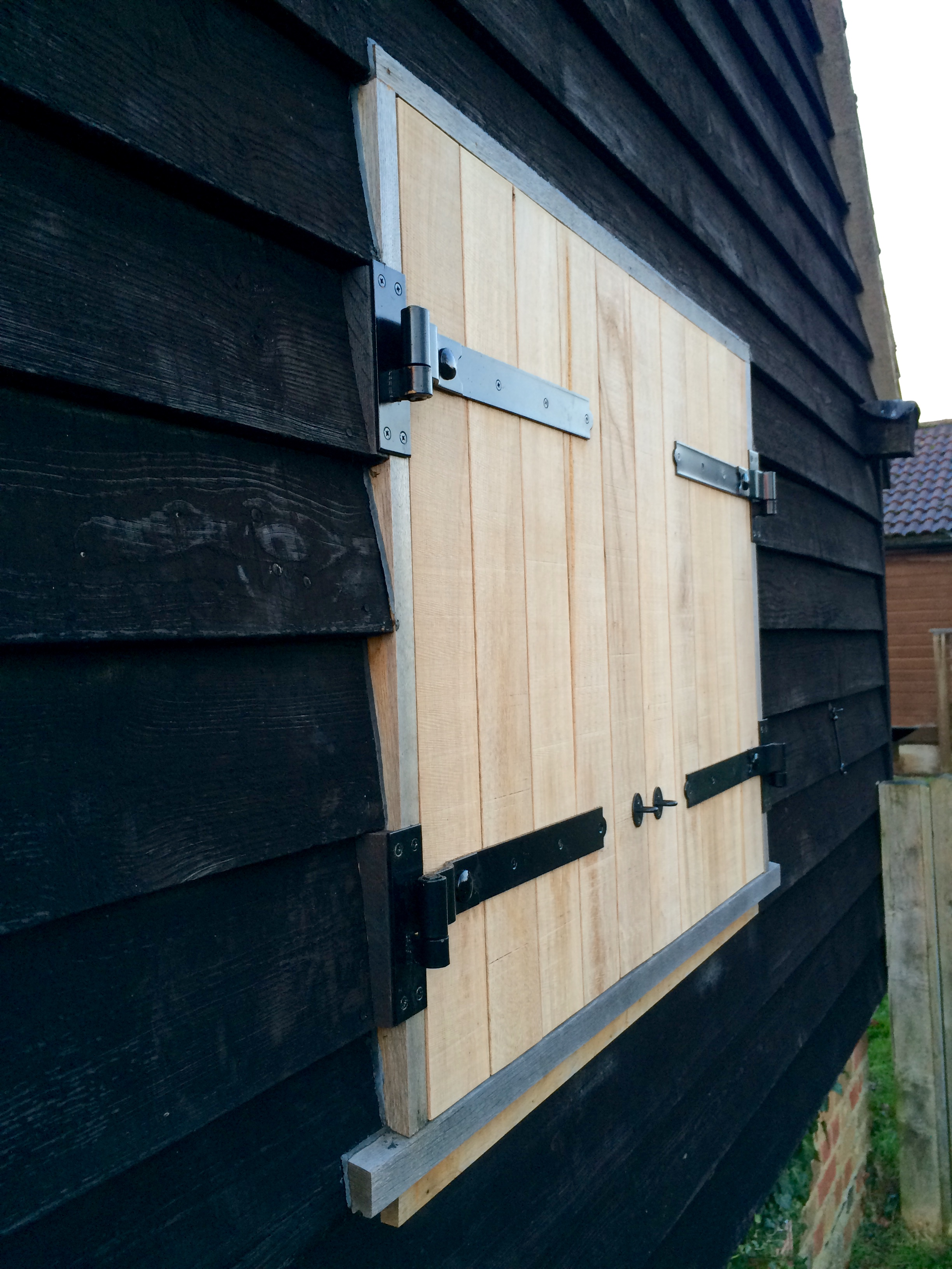 - Solid oak window shutters help to offer both security and weather protection to this lovely old barn. The oak will silver naturally with age.