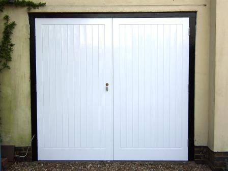 - Traditionally built garage doors. These are braced and ledged with mortise and tenon joinery throughout. The frame is hardwood, the doors are made from joinery grade softwood. The tongue and groove panels were primed before assembly. This offers protection from the elements, whilst also allowing for expansion and contraction of the various elements without leaving exposed timber on show.