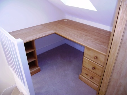 - Built as part of a loft conversion fit out, this desk matches other furniture within the space.
